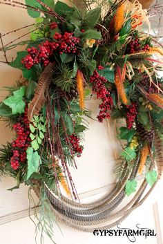 Ever since I was in Floral Design in my high school ag class, I have been making rope wreaths. You see, my dad, brother, and I were all team ropers and we . Fall Wreaths, Door Wreaths, Christmas Wreaths, Christmas Ideas, Western Wreaths, Western Decor, Western Style, Cowboy Christmas, Country Christmas