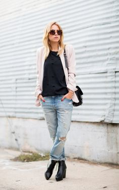 Courtney Trop of Always Judging contrasts her black t-shirt with a pastel blazer // #Fashion #StreetStyle