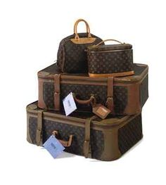 TWO SATELLITE SUITCASES, A NICE BEAUTY CASE AND A DEAUVILLE BEAUTY BAG  LOUIS VUITTON, 20TH CENTURY   the suitcases lined in cream linen, the interiors with blouson pockets to either end, with two monogram linen straps, buckle closure straps to the exteriors and with padlocks and missing keys, one with a luggage name label; the soft-sided beauty case with washable lining; the soft-sided beauty bag with pockets and elasticated bottle holders to the interior, with a luggage name label, padlock…