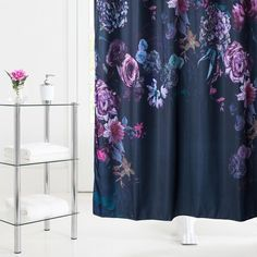 Add new life to your bathroom with a bold and brightly printed shower curtain.