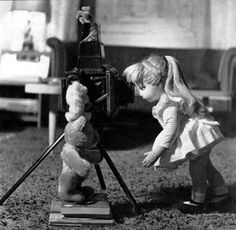 """Dare Wright's doll Edith, left, and fellow series star Little Bear play with a camera and their teddy bears. Photo from """"The Secret Life of the Lonely Doll"""""""