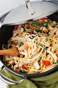 Pasta, cream sauce, shredded chicken, fresh spinach, tomatoes, and lemon juice come together for a filling and elegant supper in less than 30 minutes. more
