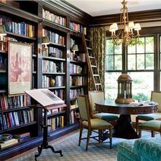 Wall-to-wall bookshelves, ladder, reading table