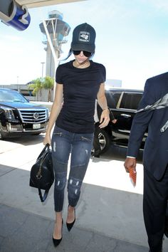 jenner-news:   August 5: Kendall boarding a flight at LAX airport in Los Angeles [HQs]