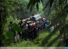 CHINA, Lushan: Villagers carry the coffin of a man killed after a magnitude 7.0 earthquake hit Lushan, Sichuan Province on April 22, 2013. Clogged roads, debris and landslides impeded rescuers as they battled to find survivors of a powerful earthquake in mountainous southwest China. AFP PHOTO/Mark RALSTON
