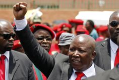 """To chants of his nickname, """"Juju, Juju,"""" Julius Malema strode by women blowing kisses and men raising clenched fists as he campaigned to whip up support for this year's election with a call to nationalise South Africa's mines, banks and land.  Click here to read the full story: http://www.iol.co.za/business/news/malema-storms-sa-politics-by-wooing-poor-1.1639232#.UuoLWaJN-lg"""