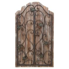 Reclaimed wood picket fence wall decor with an iron gate overlay.   Product: Wall décorConstruction Material: Ir...