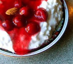 Danish Rice Pudding:  Risalamande is the dessert that is traditionally served with Christmas dinner in Denmark. Rice is cooked in milk and left to cool and set, then whipped cream, sugar vanilla and almonds are folded in and warm cherry sauce is poured on top.