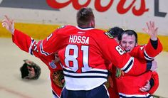 Corey Crawford #50 celebrates with teammates Marian Hossa #81, Andrew Shaw #65 and Jonathan Toews #19 after defeating the Tampa Bay Lightning by a score of 2-0 in Game Six to win the 2015 NHL Stanley Cup Final at the United Center on June 15, 2015 in Chicago, Illinois.