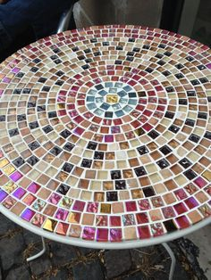 Mosaic table top in red, blue, brownish