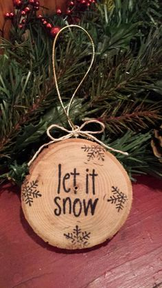 Let it snow, Let it snow, Let it snow!....is the simple message of this handmade, rustic word slice ornament. The letters are hand stamped. The ornament is protected with polyurethane, has a simple bow and gold hanger to hang on your tree or in your favorite spot! : )    Makes a great Christmas gift! Also would be a cute idea for a gift tag or around a wine bottle