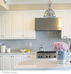 Crisp and classic kitchen featuring Cocoon Mosaic ceramic tile in Pale Sky Gloss. Available at: http://hamiltonparker.com #housetrends
