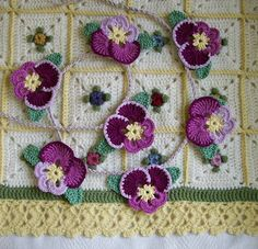 Knot Garden: Pansy Bunting--beautiful for spring.  Keep following the links down the rabbit hole--eventually you'll find the free pattern for how to make the pansy motif.