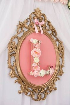 Pink & gold monogram decoration for a princess birthday party