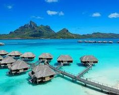 Bora Bora - One day, I will be in one of those little huts lounging away...it will happen! ;)