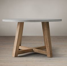"RH's Salvaged Wood & Weathered Concrete Beam Round Dining Table:Our table pairs a 3""-thick slate grey concrete top with the natural…"