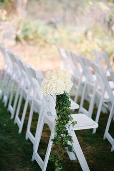Elegant + unique wedding ceremony aisle marker idea - white hydrangeas and cascading ivy {Millie B Photography}