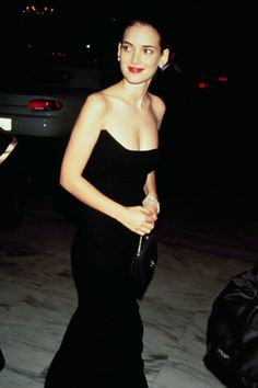 Where: Academy Awards in 1990 Why: Ryder looks timeless in a strapless black gown and red lip.