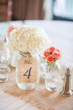 Burlap and mason jar wedding centerpiece via Sara Purdy Photography / http://www.himisspuff.com/wedding-table-numbers-centerpieces/