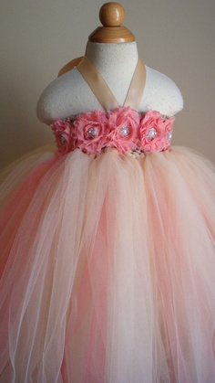 Tutu dress! Would be perfect for a photoshoot!! This would be so easy to make! Use head band, tie the took in the bottom holes! Tie ribbon at top for strap and then hot glue gun bows on there!!