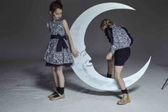Cosmic print dresses by Jessie and James for winter 2016 at Petit Fashion