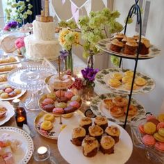Dessert buffet; macaroons, mini lemon tarts, Portuguese tarts, turkish delight, baklava and sticky date pudding. Beautifully presented on vintage platters and stands amongst fresh flowers, candles and a gorgeous simple wedding cake.
