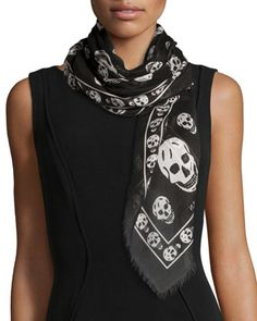 Skull Print Fringe-Edge Scarf, Black by Alexander McQueen.  While I wouldn't wear this around my neck, it would look fabulous tied around one of his satchels.