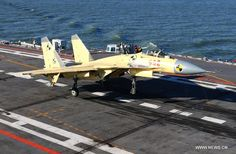 Shenyang J-15 Flying Shark naval-based fighter landing on board aircraft carrier Liaoning, People's Liberation Army Navy (PLAN).