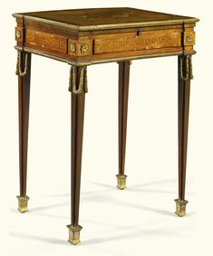 A Louis XVI gilt-bronze-mounted kingwood, rosewood and mahogany marquetry work table circa 1775, attributed to Philippe-Claude Montigny -- Sotheby's