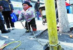 Heartbreaking pictures of the Chinese toddlers tied up all day because their parents can't afford child care Toddler Ties, Innocence Lost, Sad Pictures, Parenting Fail, Asian History, Two Year Olds, Tied Up, Oppression, Childcare