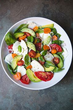 A recipe for an updated take on the traditional caprese salad with ripe avocado, shallots, and a hint of lemon to play nicely with the fresh basil, summer tomatoes, and fresh mozzarella. How To Cook Zucchini, How To Cook Asparagus, Cooking Zucchini, Cooking Turkey, Cooking Lamb, Cooking Pumpkin, Cooking Steak, Cooking Bacon, Clean Eating Recipes