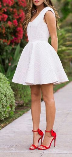 Love the whole white dress with red statement heels.