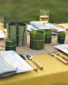 Set the mood for a luau by wrapping candle holders in plant leaves (try hostas, calathea, or banana leaves), bringing the feel of lush island greenery to the table.