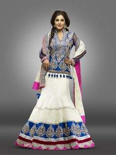 Pure georgette ghagra choli.  Ghagra is an off white colour. This ghagra has Lucknow work with self threads.  The skirt has a myriad of colors, blue, pink, red and silver colour patch with Badhla work on it.  Blouse is a blue colour gorgette material with full silver and golden badhla work.  The Blouse has a long sleeve with blue net.  The Dupatta is pure georgette in off white colour with self lucknow work .  Duupatta's border is in pink and blue colour.