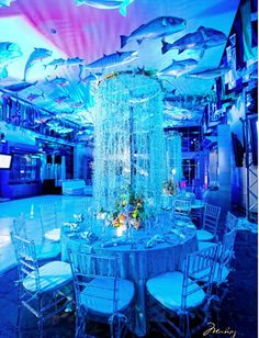 Underwater decor.  Hula hoops with ribbon, chiffon and crystal embellishments suspended over each table.