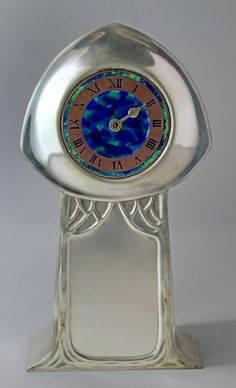 www.veniceclayartists.com wp-content uploads 2011 08 Liberty-and-Co-Tudric-pewter-and-enamel-clock.jpg