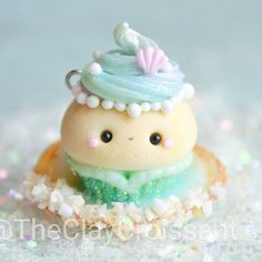 A mermaid cupcake figurine I made a while back for @hmmmbrilee. her artwork is simply stunning  so please take a moment to check out her page. ❤ It's hard to really see from this angle but I have the cupcake sitting in a seashell that I filled with water (light blue cupcake frosting) and decorated with my sand mixture. :) #polymerclay #polymerclaycharms #claycharms #clay #charms #pendant #jewelry #food #foodie #foodjewelry #cutefood #kawaiifood #handmade #diy #etsy #crafts #custom #mermaid…