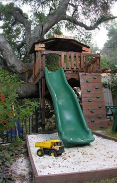 love sand box at the end of the slide. Rock wall. Swings. Maybe a hammock underneath.