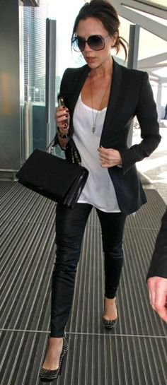 Victoria Beckham in a modern take on a suit - especially love the tailored blazer/necklace combo and skinny jeans w/heels
