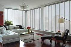 Sliding Panels, also known as Panel Tracks, are a stylish, updated alternative to vertical blinds and draperies.The options are endless! Contact us today to start customizing your windows. #panels #windows #drapes
