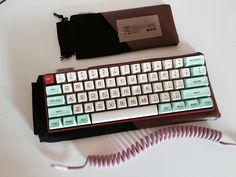 Poker 2 MX reds JukeBox SA Caps Red Aluminum 60% case from Qtan Candy Cane coiled cable from /u/90N1NE[1]