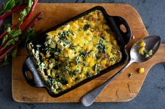 Chard & Sweet Corn Gratin -- NYT Cooking __  Extra-virgin olive oil 1 generous bunch Swiss or rainbow chard, stemmed and washed Salt 2 large garlic cloves, minced 1 teaspoon chopped fresh rosemary 1 teaspoon fresh thyme leaves Black pepper 3 eggs ½ cup milk 2 to 3 ounces Gruyère, grated (1/2 to 3/4 cup), to taste Kernels from 2 cooked ears sweet corn (1 1/2 to 2 cups) 1 ounce Parmesan, grated (1/4 cup)