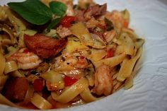 Shrimp and andouille sausage, cooked in a buttery sauce tossed with fettuccine, fresh herbs, artichokes and pimentos.