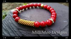 Stunning Stunning Stunning!! Semi Precious natural Red Coral Round 8mm Bead Bracelet with Gold Plated Metal Snowflake Beads by MilliMooDesigns on Etsy