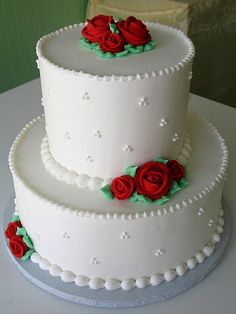 Beautiful white cake with small roses.