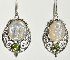 """Man On The Moon Peridot and White Shell Sterling Silver Earrings -  A round white shell with the """"Man on the Moon"""" face carved into it. Underneath the shell is a smaller round green peridot surrounded by a half moon shaped scroll design in polished silver. http://simplybeautiful2012.com/man-on-the-moon-peridot-and-white-shell-sterling-silver-earrings.html#"""
