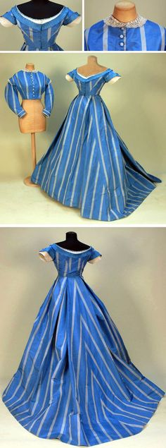Silk taffeta gown with two bodices, 1860s. French blue with wide grey stripe, day bodice with long collared sleeve, lace collar & cuff trimmed in cream bobbin lace. Short -sleeved evening bodice with open neck trimmed in pleated ribbon, white net, & velvet ribbon, both bodices cut straight at waist. Voluminous, unlined trained skirt has large pleats, off-center front closure, hem with deep stiffened backing to raise hemline by 3-4 inches. Whitaker Auctions