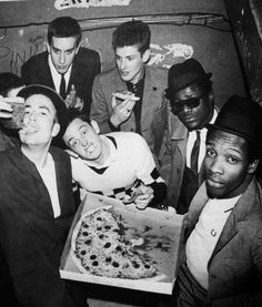 The Specials enjoy a pepperoni pizza