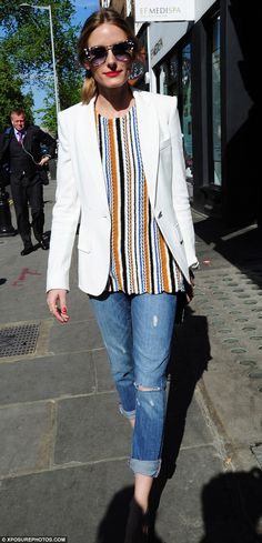 Style icon: Fashionista Olivia Palermo, who hosted the event, wore a classic white blazer with ripped jeans and a striped crochet top