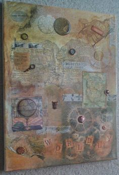Worldly mixed media collage   By, Erika Kolstad. Tim Holtz inspired. Sizzix, Ranger, and Ideology products used
